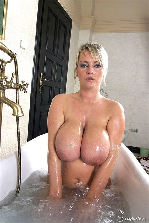 Bea Flora Washing Her Giant Tits In The Bath Tub 1 Of 1