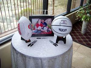 have guests sign football or basketball at welcome table With wedding table sign ideas