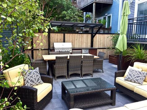 backyard place patio with a fireplace and a gas grill in chicago