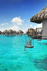 Over water bungalows with steps into lagoon luxury beach for Honeymoon huts over water