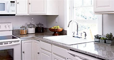 how to set kitchen cabinets white kitchen appliances disappear against coordinating 7358