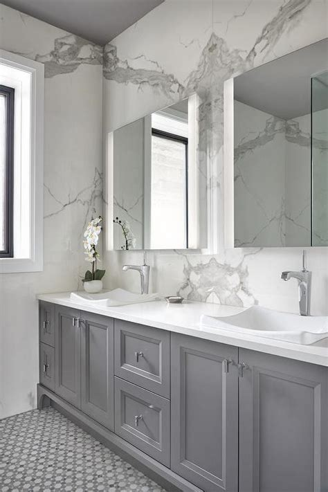 gray bath vanity cabinets  white subway tiles