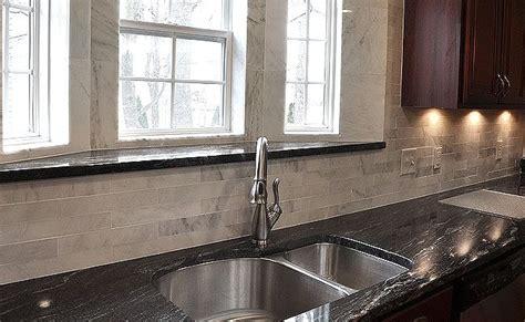 Black Countertop Backsplash - black granite and cabinets lighten up kitchen with