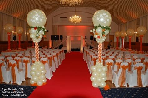 Orange And Ivory Balloon Columns Make A Stunning