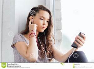 Teenage Girl With Smartphone And Earphones Stock Photo ...