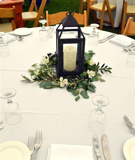 Vintage Lantern Wedding Centerpiece Surrounded By White