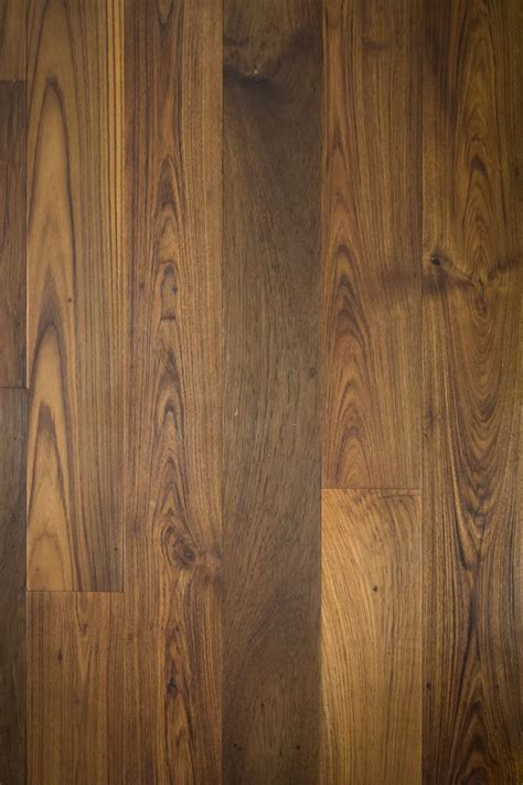 wood flooring wall paneling we love wide plank reclaimed teak wood for wall cladding paneling and for flooring traces of