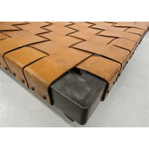Woven fiber exterior with brushed metal pulls. Industrial Woven Leather and Steel Coffee Table | Chairish