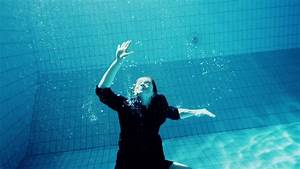 Drowning underwater businesswoman struggling to make it ...