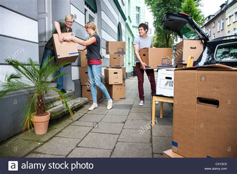 moving into a new apartment friends help carrying moving