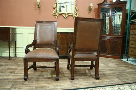 2 large mahogany leather upholstered dining arm chairs