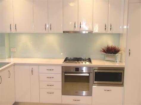 white kitchen with green glass splashback glass splashback this light mint colour the best 2105