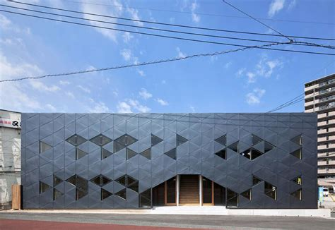 Wall Corner Stand by Dabura Patterns Commercial Building Full Of Triangles In Japan