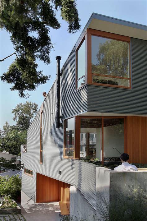 corrugated steel house  warm wood details