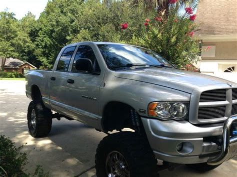 find  lifted  dodge ram  quad cab  slt