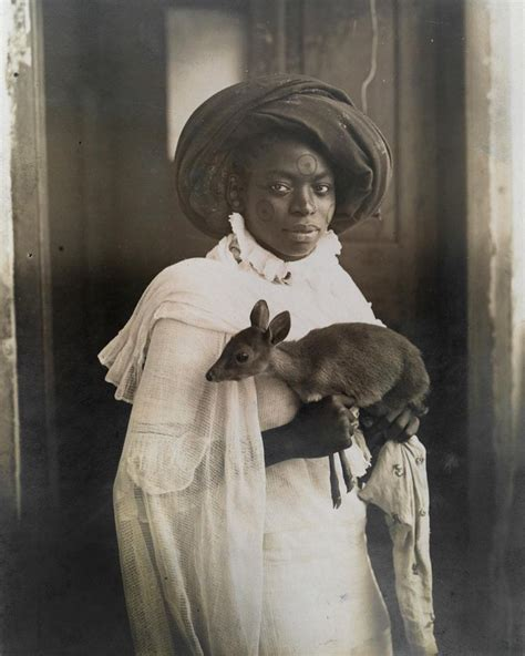 """Archive 📽 On Instagram """"a Young Kenyan Woman Holds Her Pet Deer In Mombassa March 1909 Ph"""
