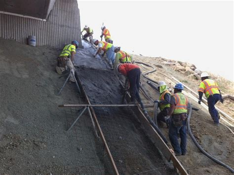 pouring concrete for lone tree way undercrossing slope