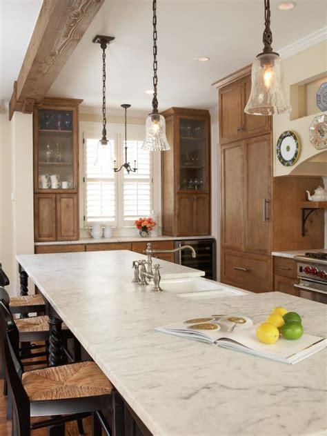 rustic kitchen  built  cabinets pendant lights