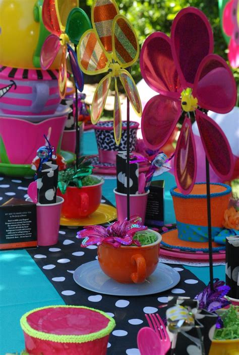in mad hatter table decorations designed