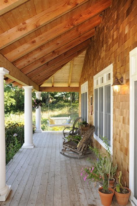 covered porch rustic patio house  porch saltbox houses