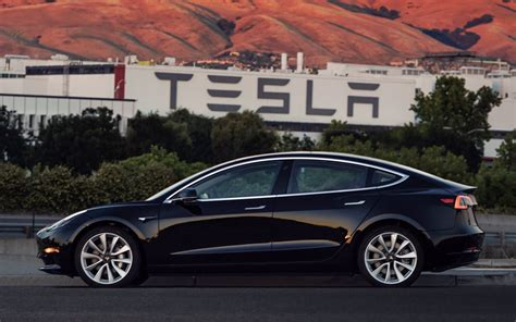Tesla : First Photo Of Tesla Model 3 Production Car, Musk Gifted