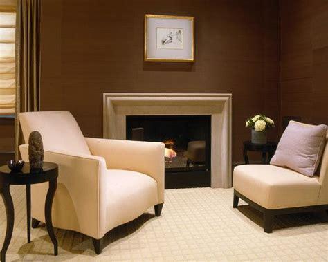white or cream fireplace surround against a dark brown
