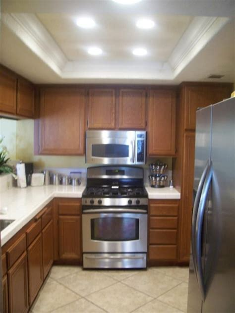 A common rule of thumb is that you use one recessed light for every 4 to 6 square feet of general ceiling lights typically use incandescent or fluorescent light bulbs. Kitchen Fluorescent Light - Sunfloweract.org