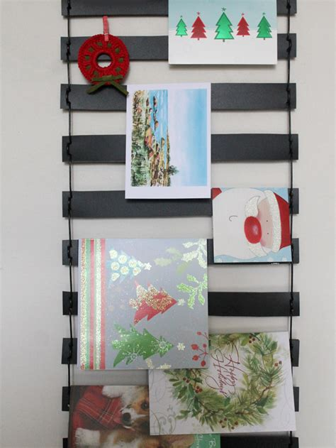 how to make a greeting card display wall hanging christmas diy loulou downtown