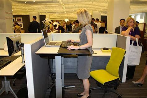 up and down desk herman miller launches desk that goes up down