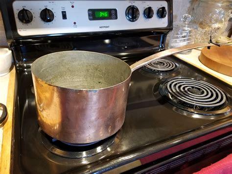 antique  quart hammered copper sauce pan  copper handle  dovetailed seams