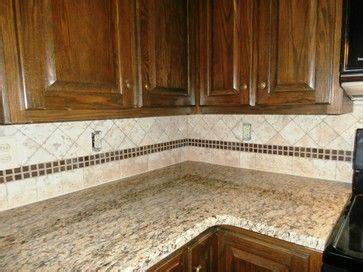 Light Cabinets With Dark Granite  St Cecilia Granite On
