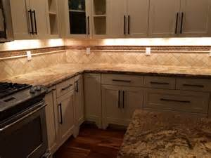 decorating ideas for the top of kitchen cabinets pictures white kitchen cabinets herringbone travertine and copper