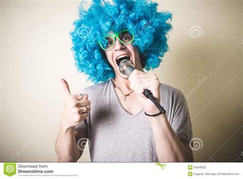 funny guy  blue wig singing stock image image
