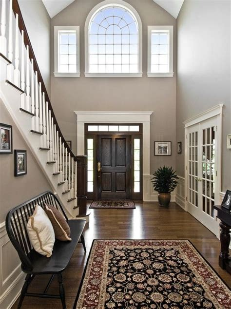 traditional entryway with high ceiling hardwood floors transom window specialty door home