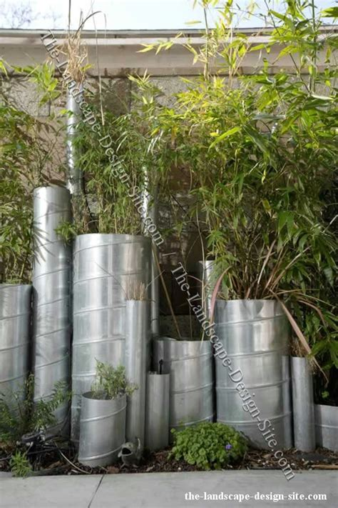 vertical metal pipes  planters  garden decor