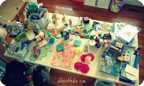 messy studio work desk   glitterandfrills