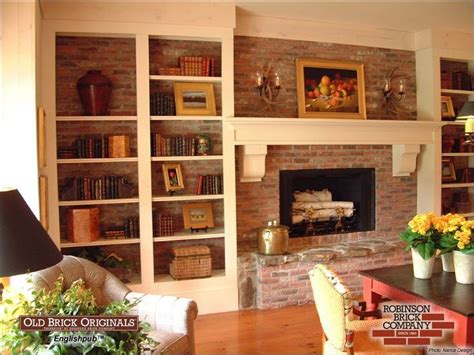 bookshelves  cover brick fireplace wall march