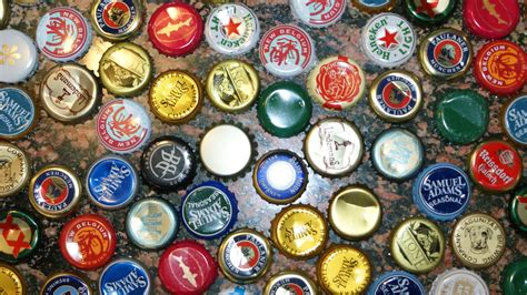 beer bottle caps full hd wallpaper  background image