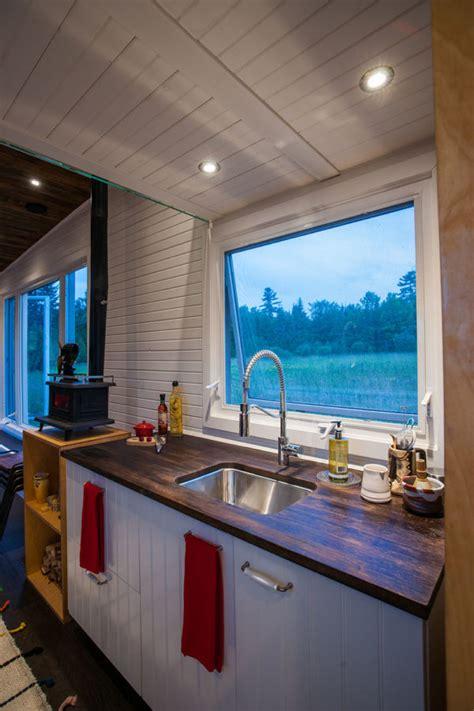 amazing greenmoxie tiny house  folding deck