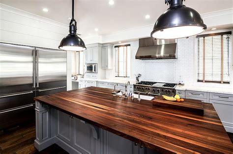 dark gray kitchen island  walnut countertop
