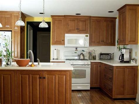 7 tips for updating melamine cabinets with oak trim. white top | White kitchen appliances, White appliances ...
