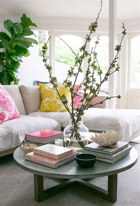 When styling your coffee table you don't want everything on the same plane, so create surfaces at different heights for groups of objects to live on. How to Style a Coffee Table - Coffee Table Styling - A Blissful Nest
