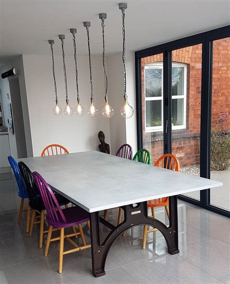 industrial based dining tables  recycled steel  iron  oak tops