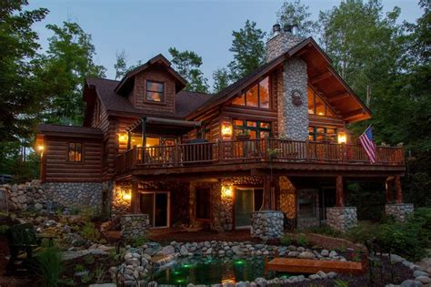 A Hybrid Log Chalet On A Walk Out Basement With Stone