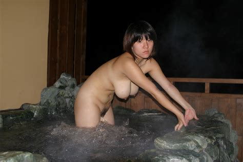 nude asian woman with hanging breasts standing in