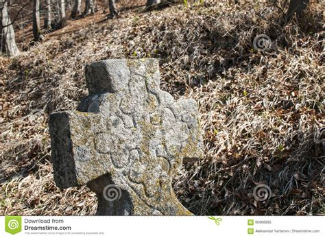 vitromex tile alpine forest tombstone christian cross closeup stock image