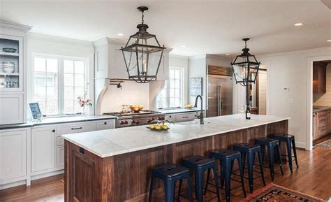 stained oak kitchen island  navy tolix stools