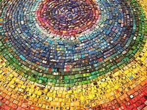 A Rainbow Mandala Made Of Toy Cars