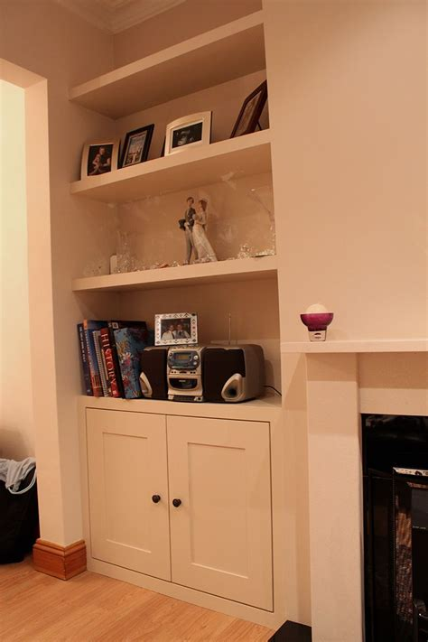 fitted alcoves cupboard  floating shelves chiswick
