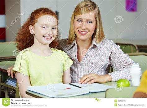 teacher giving girl private lessons  school stock